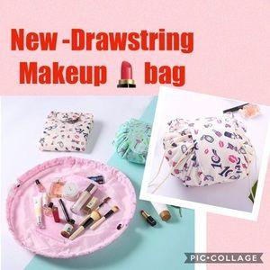 "New- ""lay & go"" drawstring makeup bag"